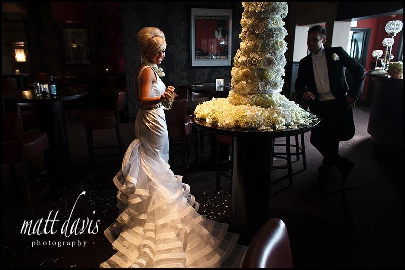 A wedding cake being sprayed at The Daffodil on a wedding day