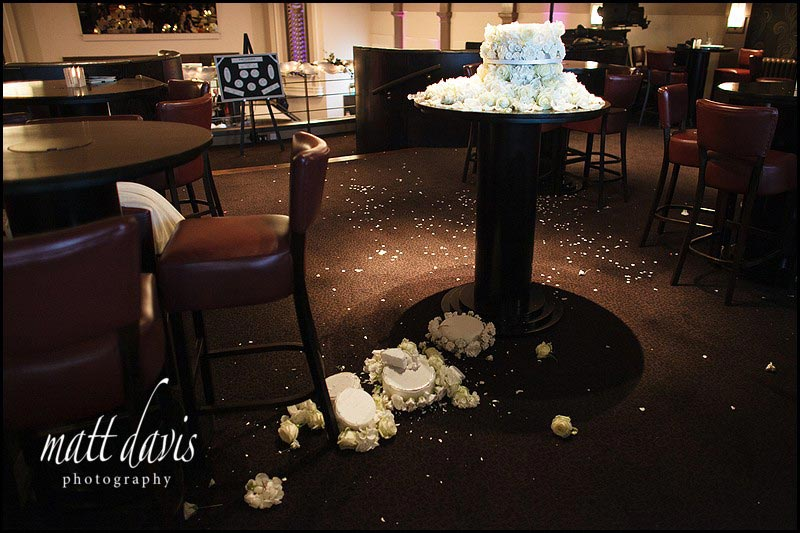 A very tall wedding cake fallen over