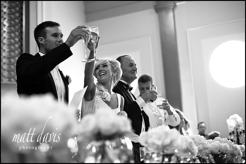 Black and white photo of wedding speeches at The Daffodil Cheltenham