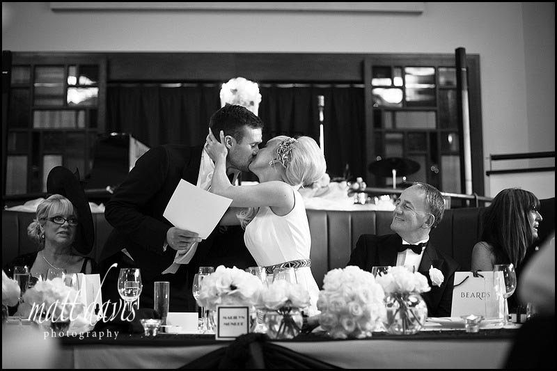 Bride kissing groom after wedding speech at The Daffodil Cheltenham