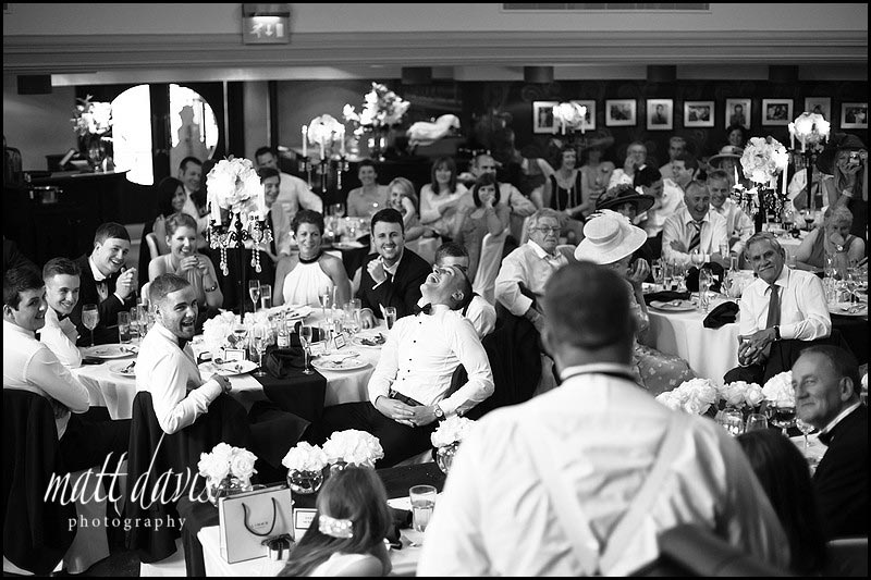 black and white photo of wedding guests by Gloucestershire wedding photographer