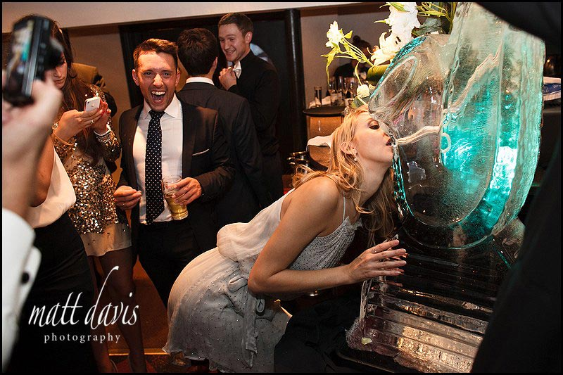 Wedding guests in Cheltenham drinking from an Ice Sculpture