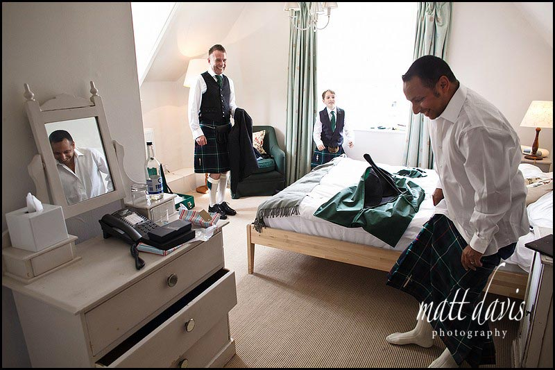 best man getting a kilt over his hips