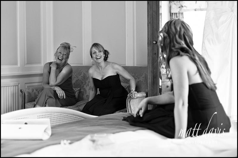 bridesmaid and mother of the bride laughing during bridal preps