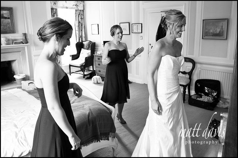 wedding dress being put on in The Rectory Hotel bridal suite