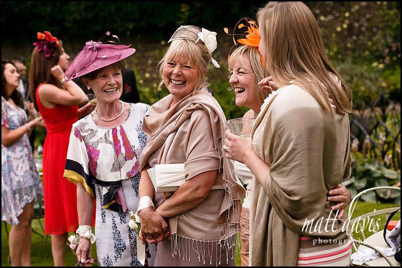 wedding guests laughing at The Rectory Hotel in Wiltshire