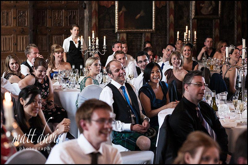 wedding guests laughing during speeches at Berkeley Castle