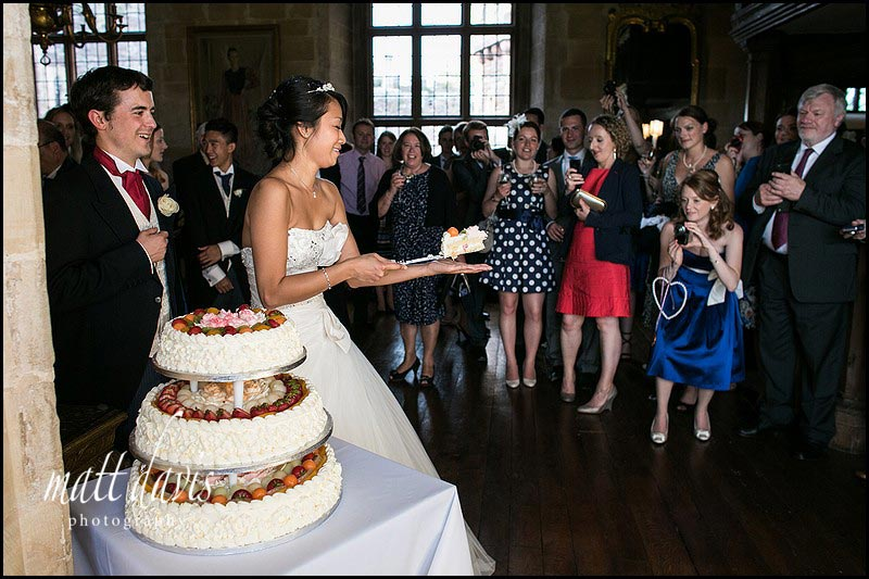 fun cake cutting at Berkeley Castle wedding