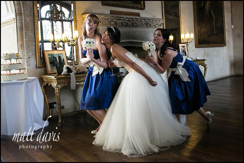 bride and bridesmaid inside Berkeley Castle