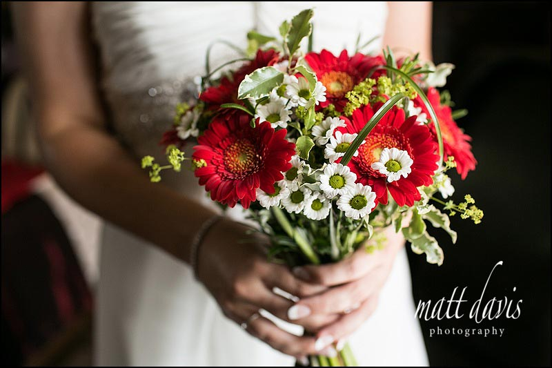 red flowers in wedding bouquet