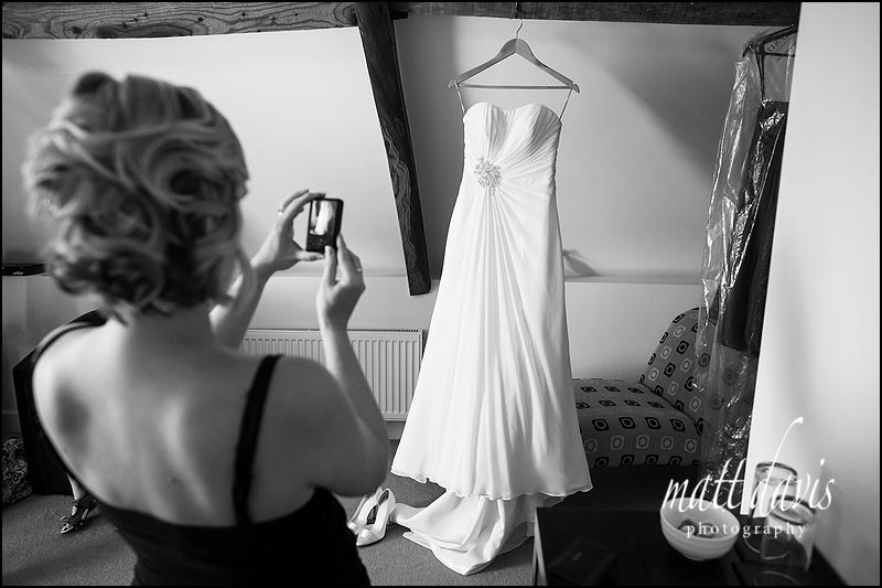 Wedding dress hung up at Kingscote Barn accommodation.