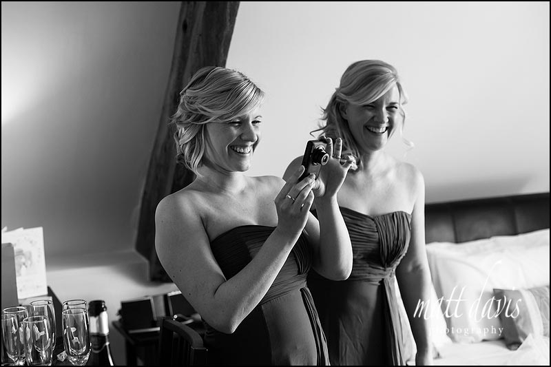 Bridesmaids taking photos