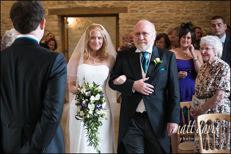 Kingscote Barn wedding photographs of bride and groom during ceremony
