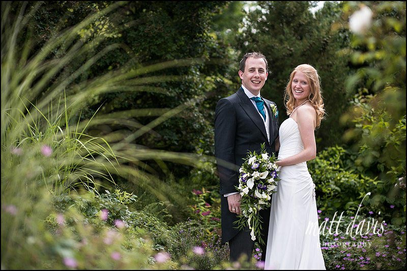 Relaxed couple wedding portraits at Kingscote Barn