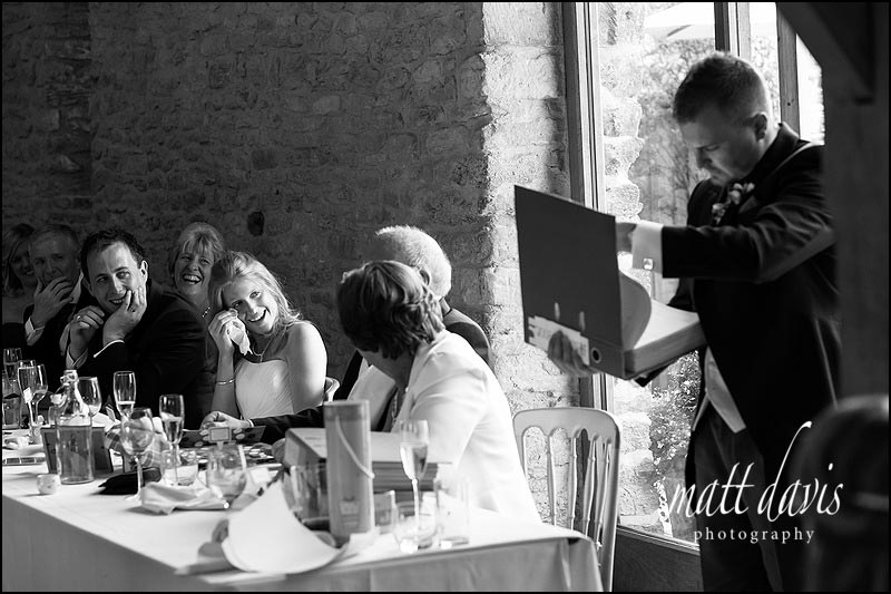 Documentary wedding photos at Kingscote Barn during wedding speeches