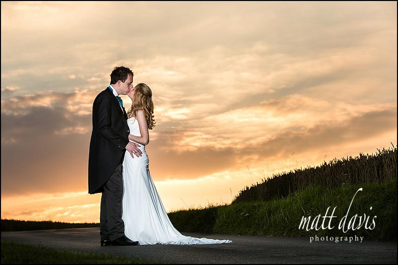 Dramatic Kingscote Barn wedding photographs