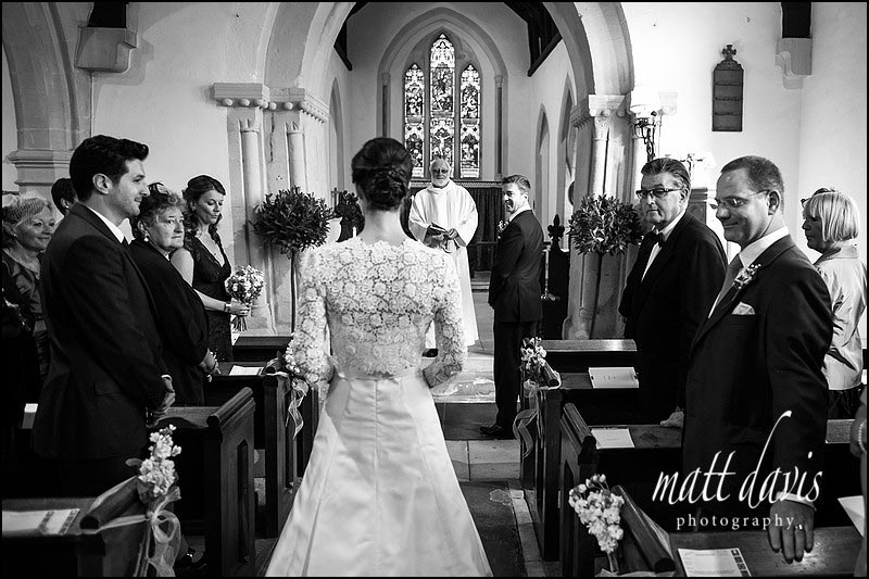 Black and white wedding photos at Barnsley Church, Gloucestershire