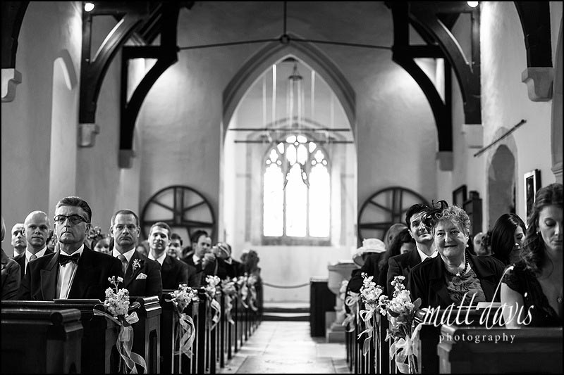 Black and white wedding photography inside Barnsley Church, Gloucestershire