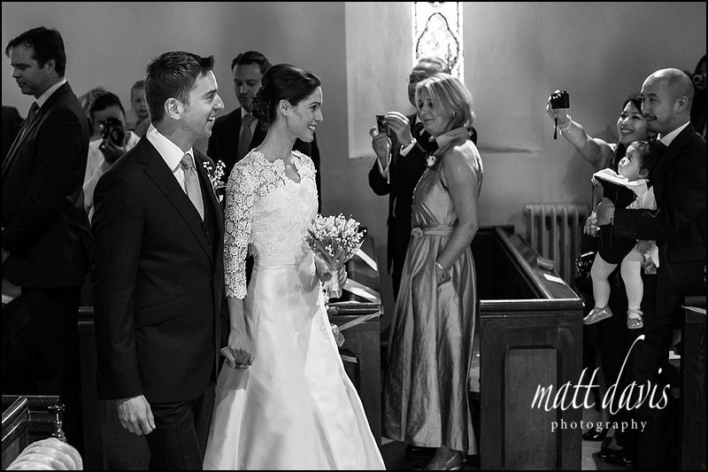 Black and white wedding photography at Barnsley Church, Gloucestershire