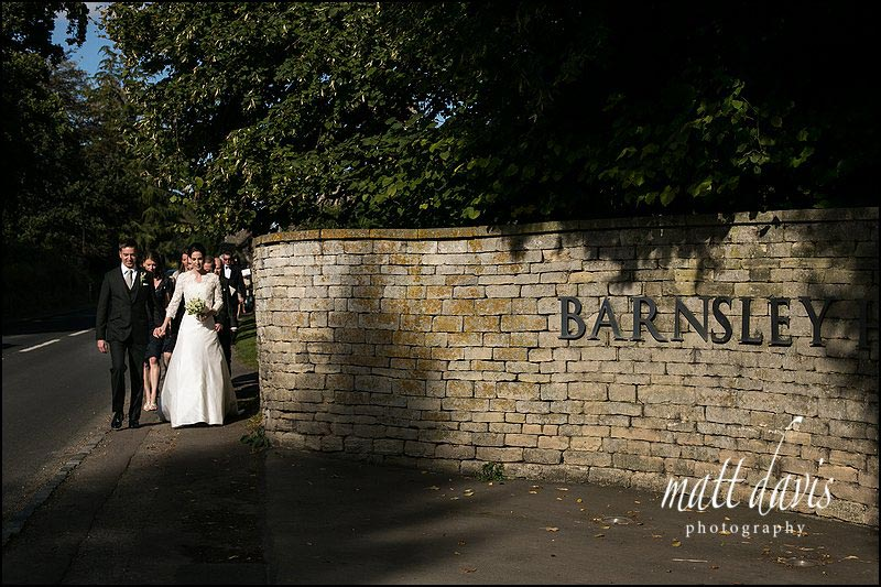 wedding couple walking to Barnsley House from church