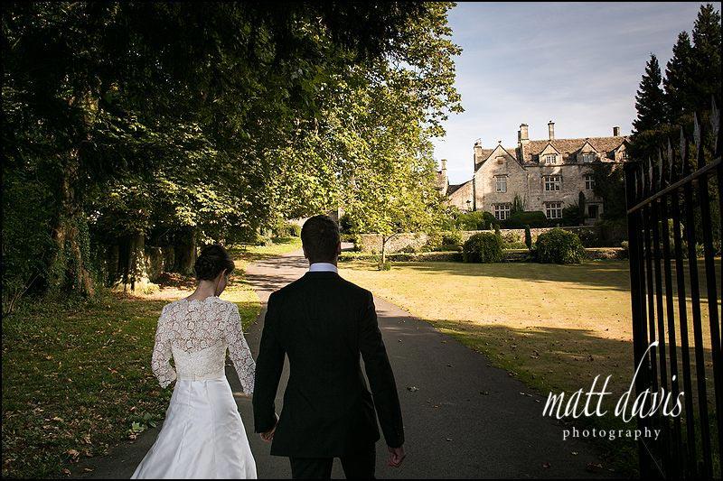 wedding couple walking to Barnsley House