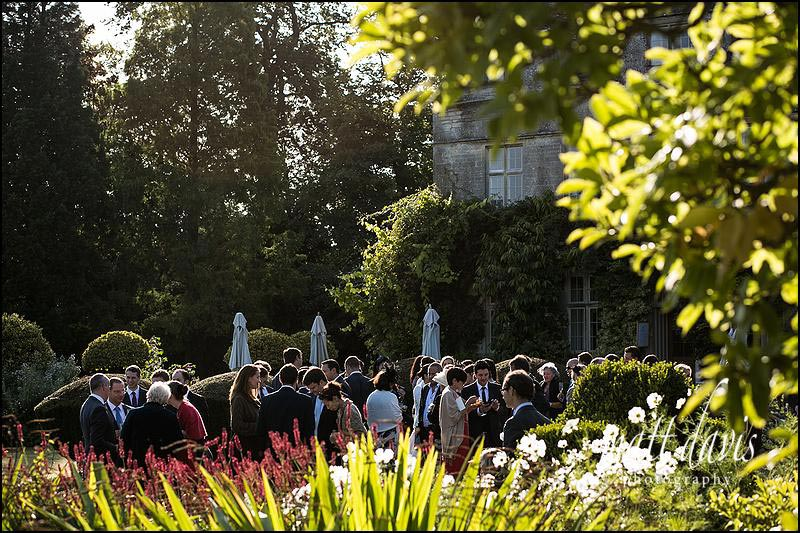 Drinks reception outside at Barnsley House weddings