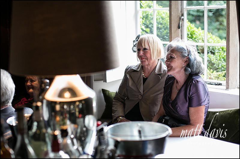 Mother of the bride and groom sat in a window seat at Barnsley House
