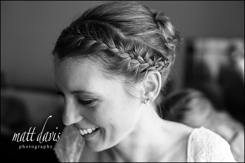 beautiful brides hair with plat to the side
