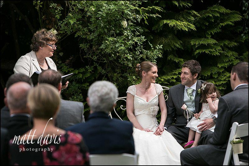 Outdoor wedding ceremony under the rose arbor at Friars Court