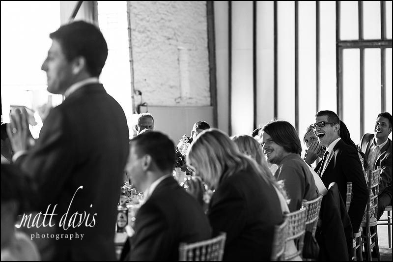 Guests laughing during speeches at Lee & Tracey's Friars Court wedding