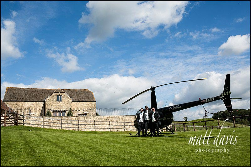 Kingscote Barn wedding where groom arrives by helicopter