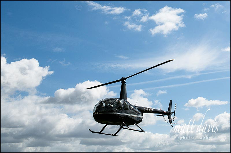 arriving at kingscote barn by helicopter