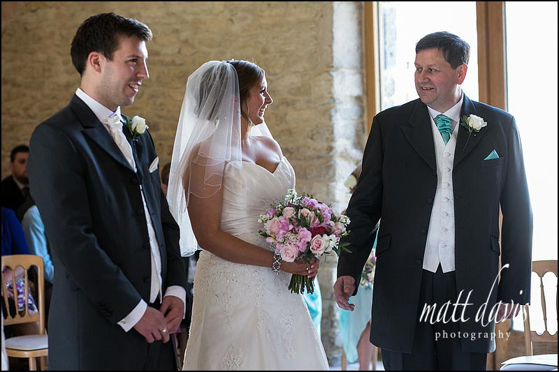Bride & groom marrying at Kingscote Barn
