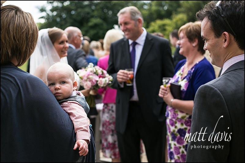 Wedding guests outside at Kingscote Barn