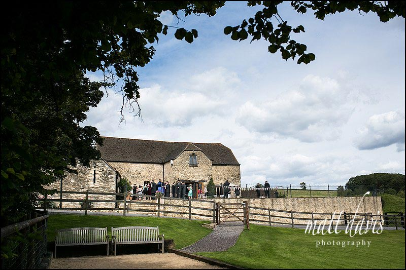 A photo of Kingscote Barn during the outside drinks reception