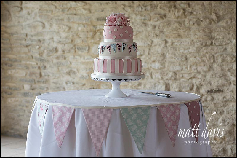Fantastic wedding cake with bold pink stripe & polka dot icing