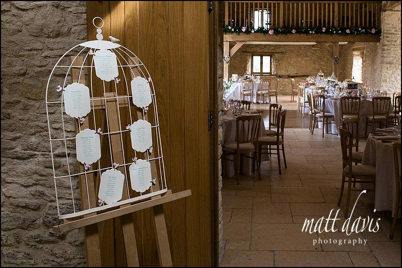 Table plan on easel at Kingscote Barn wedding