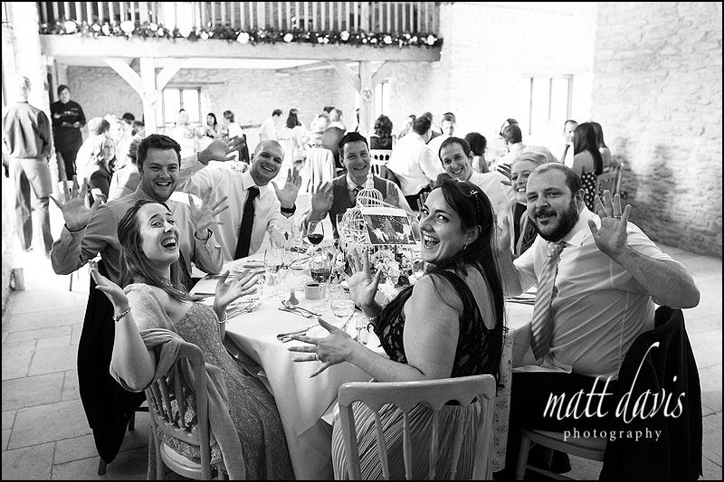 Fun guests photos during dinner at Kingscote Barn wedding