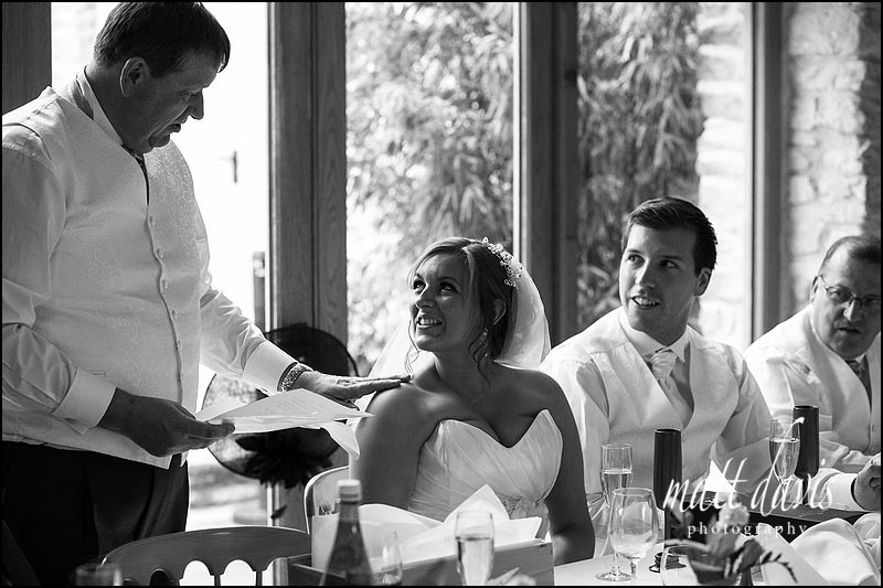 Black & white photos by Kingscote Barn wedding photographer