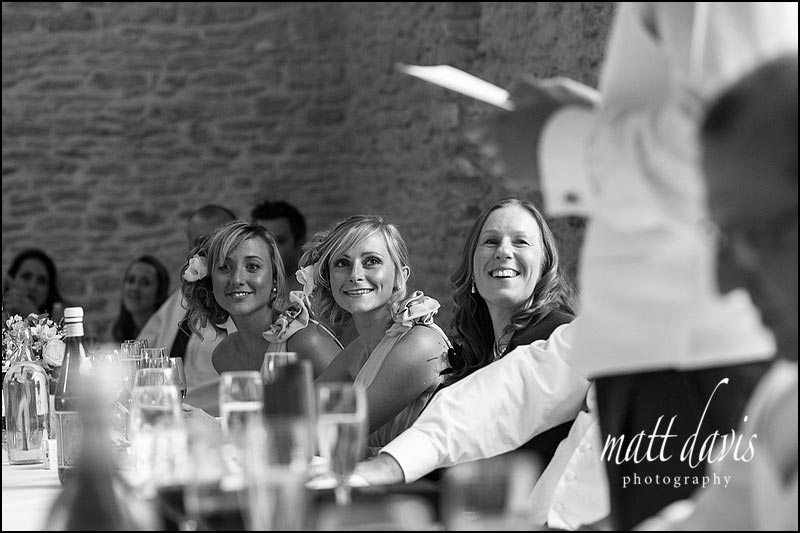 Bridesmaids watching speeches at Kingscote Barn wedding