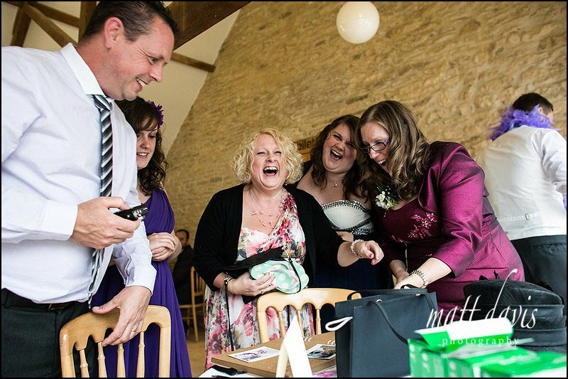 Candid moments by wedding photographer Matt Davis taken at Kingscote Barn