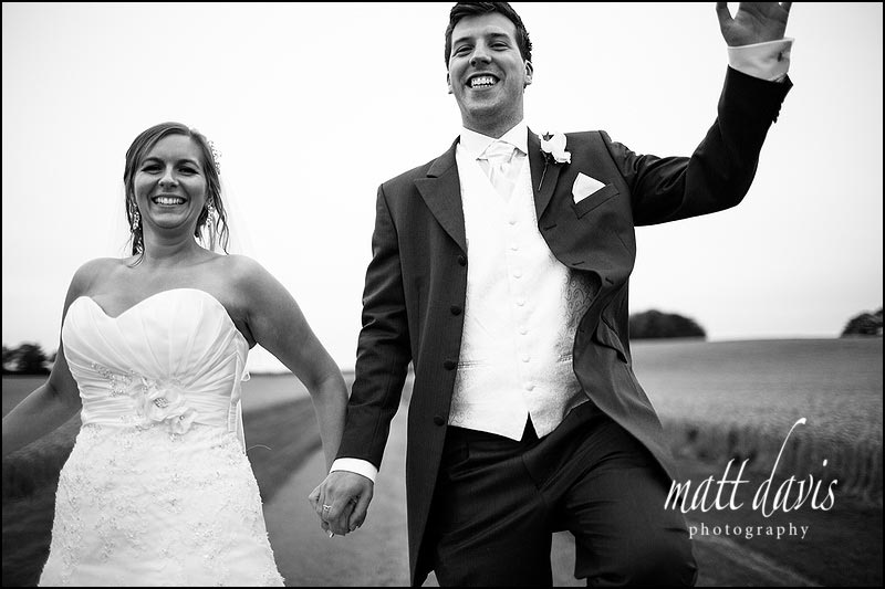 Comedy photo of Bride & Groom skipping