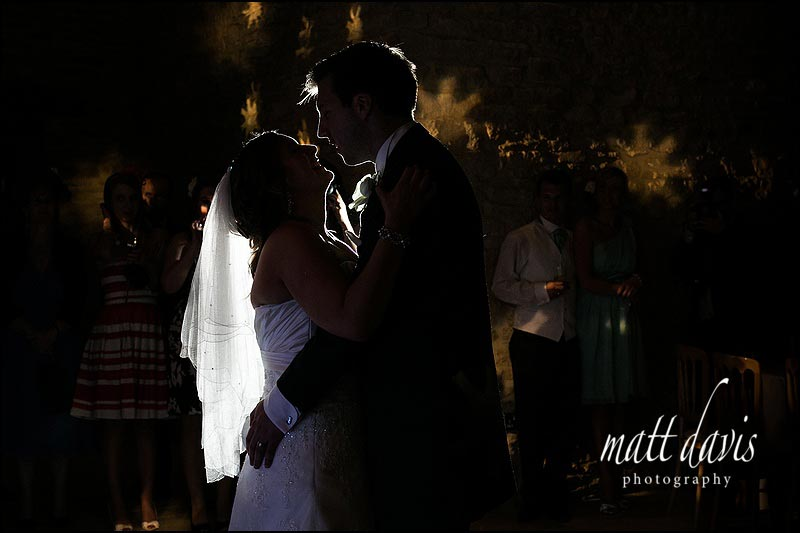 Kingscote Barn wedding photographer Matt Davis takes dramatic first dance wedding photos