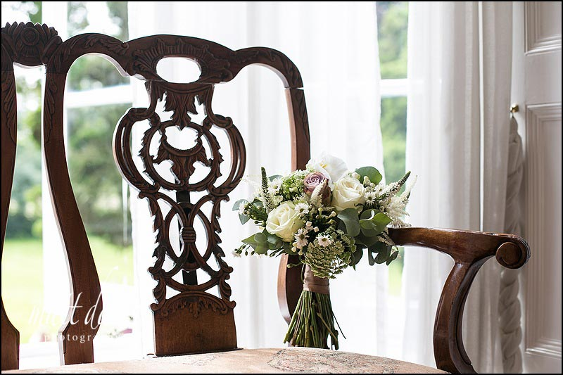 Brides bouquet on wooden chair