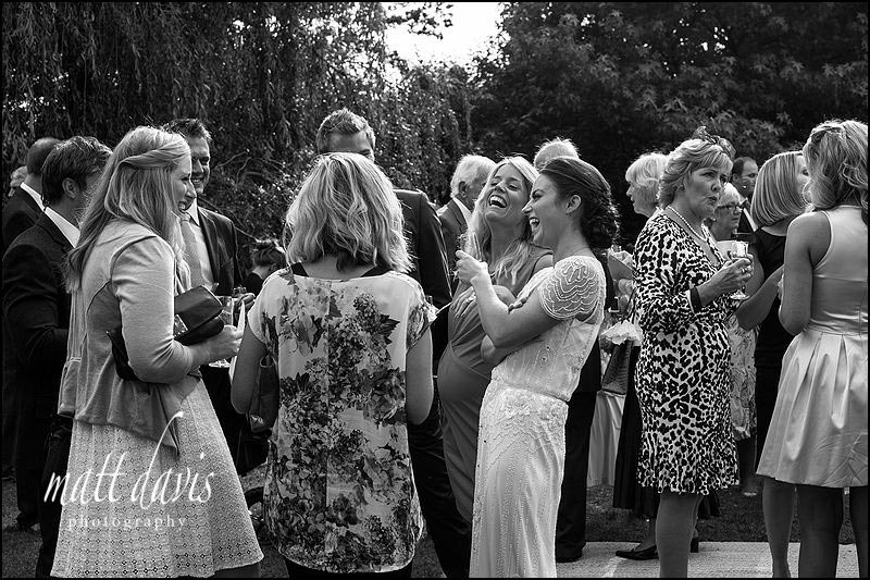 black and white photos of Wedding guests during the drinks reception