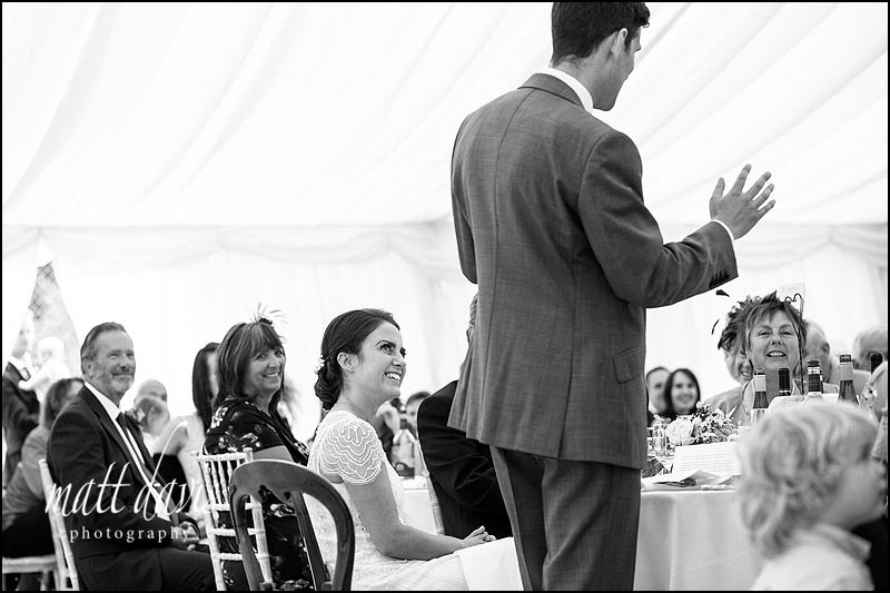 Reaction photo taken during grooms speech at a marquee wedding in South Wales