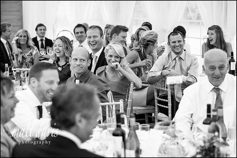 Wedding guests enjoying a marquee wedding in South Wales