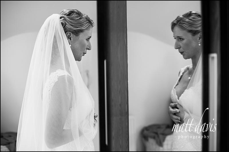 Bride taking a deep breath before wedding