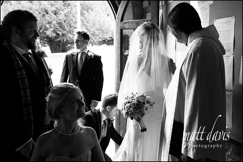 Wedding photo in the doorway of St Andrew's church, Naunton