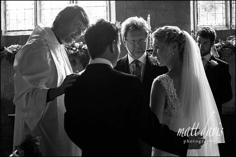 Wedding photography during the ceremony at Naunton Church,  Gloucestershire